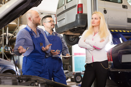 Woman and two auto mechanics